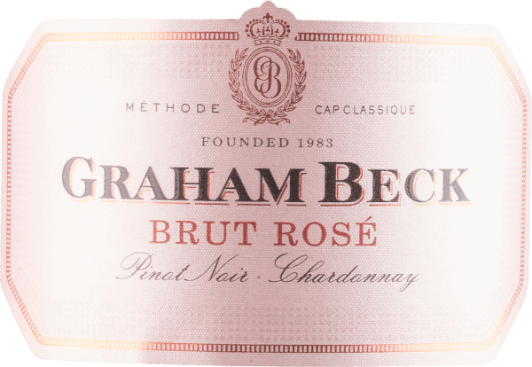 """Der Brut Rosé von Graham Beck Wines funkelt im Glas in einem zarten Rosa mit silbernen Reflexen. Sein Bouquet verzaubert mit den herrlichen Aromen roter Beeren und Kirschen. Dieser südafrikanische Schaumwein ist am Gaumen sehr cremig mit einer animierenden Saftigkeit und einer lebendigem Perlage. Die Beerenaromen werden belebt durch die feine Säure und tragen in einen eleganten Nachhall. """"Dieser Wein ist ein vollendeter Allrounder. Mit Sicherheit elegant und raffiniert, dabei aber auch ausgelassen und rassig """", sagt Pieter Ferreira, Kellermeister von Graham Beck. Vinifikation des Brut Rosé von Graham Beck Wines Der Brut Rosé wird nach der Methode Cap Classique hergestellt. Dieser Begriff etablierte sich 1992 in Südafrika um lokalen, nach der Champagnermethode hergestellte Schaumweine zu bezeichnen, da die Bezeichnung Champagner geschützt ist und nur für Schaumwein aus der Champagne verwendet werden darf. Die Trauben der beiden verwendeten Rebsorten Chardonnay und Pinot Noir wurden handverlesen und einzeln fermentiert. Anschließend erfolgen die Auffüllung mit Reservewein, Abfüllung und die Hefekontaktzeit von 15 Monaten vor der Degorgierung. Eine spezielle, enzymatische Reaktion während des Transportes der Pinot Noir Trauben führt zu seiner herrlichen silber-rosanen Farbe. Speiseempfehlung für den Graham Beck Brut Rosé Genießen Sie diesen Schaumwein als Aperitif, zu leichten Desserts oder auch zu Zwiebelkuchen. Prämierungen für den Graham Beck Brut Rosé John Platter: 4/5 Sterne Tim Atkin: 91 Punkte Veritas: Gold Medaille"""